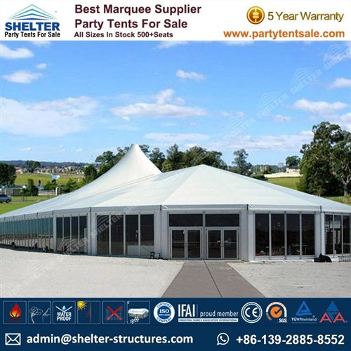 White Tent With Glass Walls Used For Outdoor Gathering